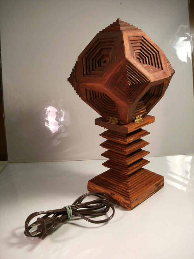 A 15-watt table lamp made of basswood.
