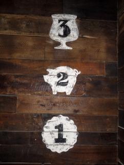 three, hand-painted wall marks