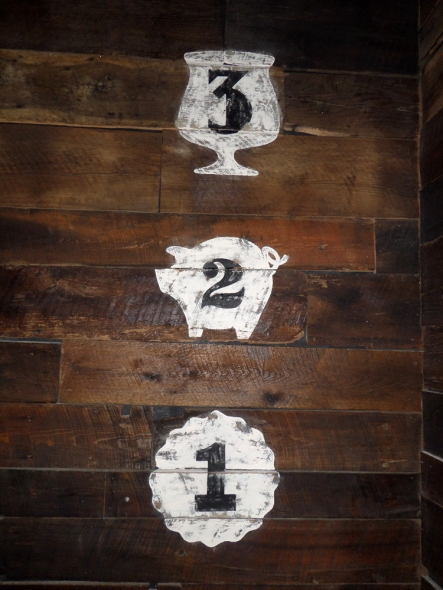three, hand-painted wall marks