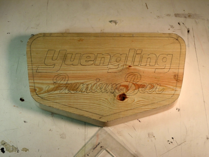 the design pressed on the wooden block